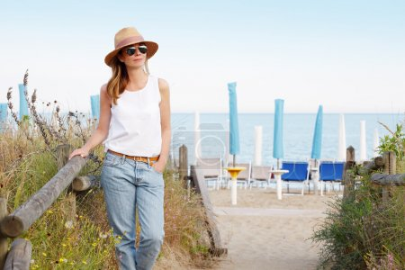 lovely woman standing on seaside
