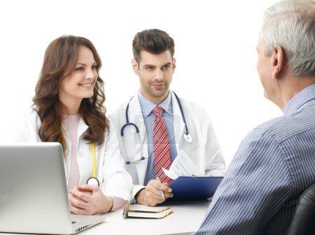 Medical team with elderly patient.