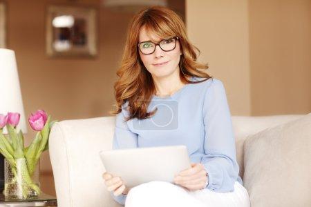 Woman using her digital tablet