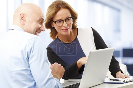 Financial officer analyzing data with businesswoman