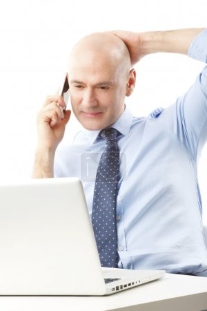 Businessman at office making call