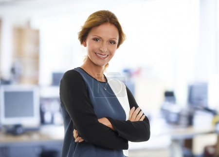 Businesswoman with arms crossed at office