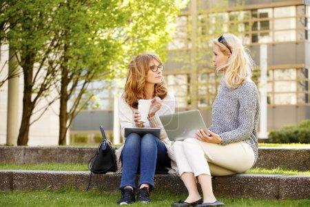 sales women talking at coffee break