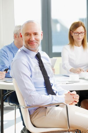 Middle age businessman sitting at office
