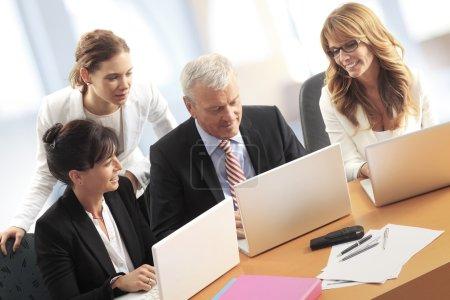 Businesswomen and businessman at office desk