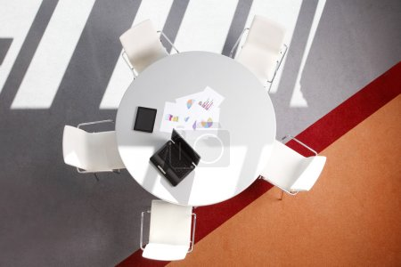 Photo for Interior of conference tablet with seat. Image from above of conference desk with digital tablet and laptop. - Royalty Free Image