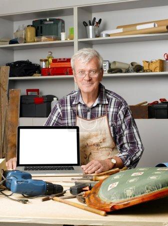 carpenter sitting at his workshop