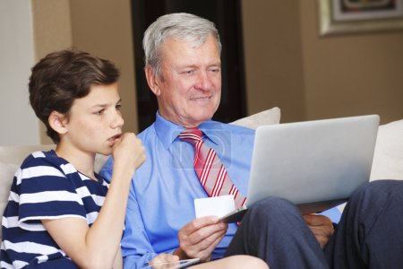 grandfather and his grandson shopping online