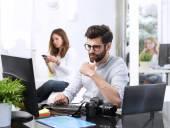 designer sitting at graphic studio