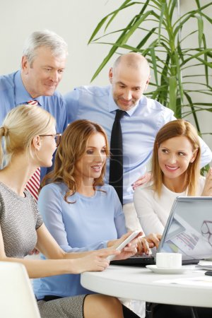 financial analyst woman in front of laptop