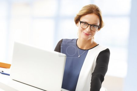 Businesswoman at office in front of computer