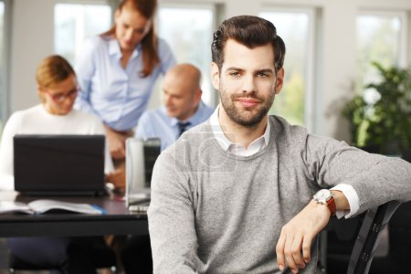 young broker sitting at office