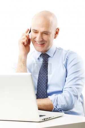 senior businessman in front of computer