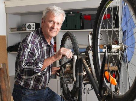 retired man working at workshop