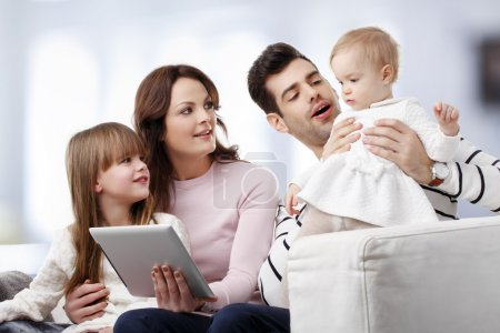 happy family watching at tablet