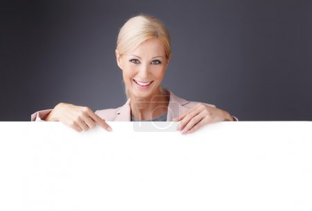 businesswoman holding a blank billboard