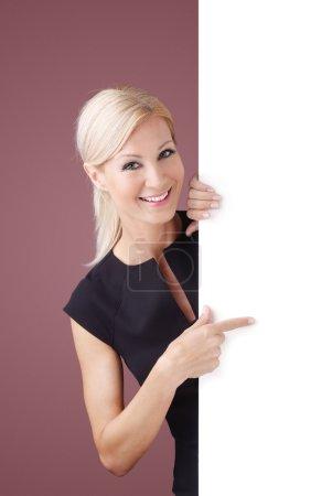 businesswoman holding billboard