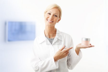 assistant holding in her hand a jar