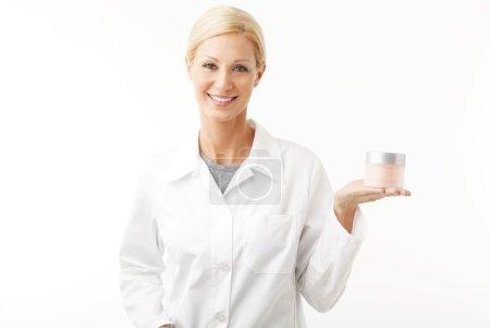 therapist holding a cream jar