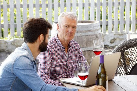 sommelier and young winemaker sitting