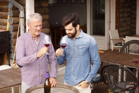 winemaker and young sommelier standing