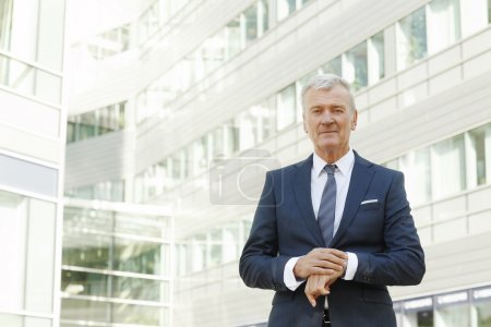 manager standing at office building