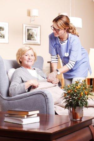 Woman  accepting caregiver assistance.