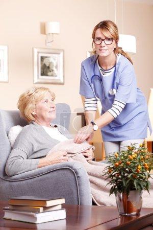 Woman  accepting caregiver assistance