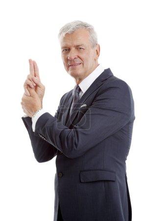 Businessman  gesturing a gun