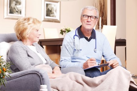 doctor consulting with elderly woman