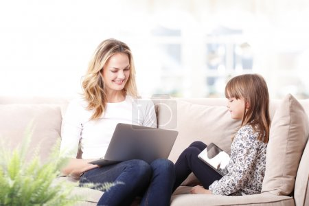 mother working  with laptop