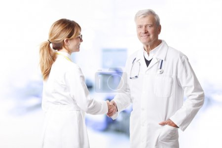 doctor shaking hands with  surgeon