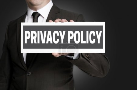 Privacy Policy sign is held by businessman