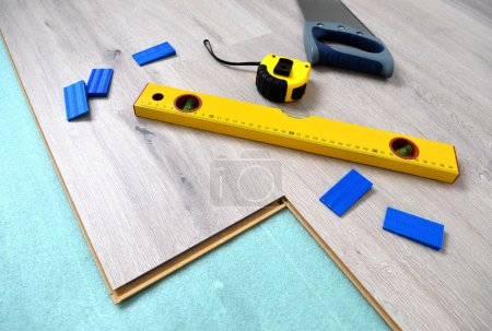 Photo for Floor panels, parquet, laminate, wood flooring and tools. - Royalty Free Image