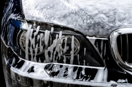 Car wash with soap. Horizontal photo.