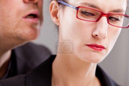 Man hissing menaces in woman's ear