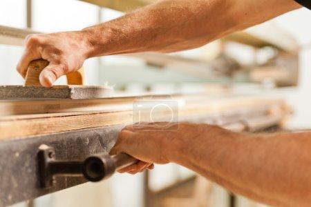 wood smoothing with belt sander