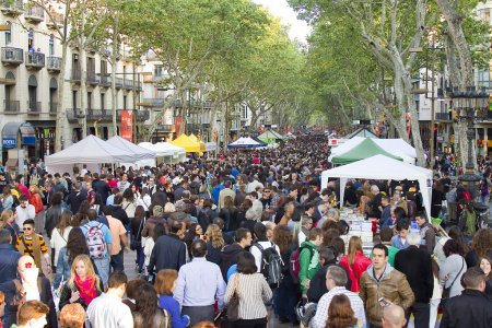 People in La Rambla during Diada de Sant Jordi or ...