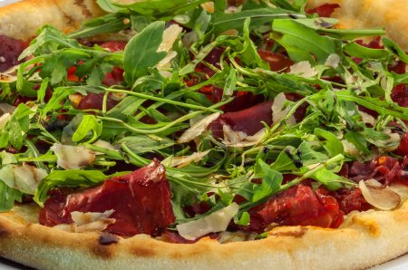 delicious pizza with bacon and arugula