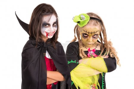 Photo for Girls with face-paint and Halloween costumes isolated in white - Royalty Free Image