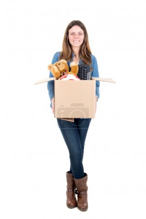 Photo for Beautiful girl with cardboard box unpacking in new home - Royalty Free Image