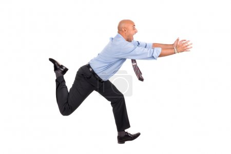 Businessman running with raised arms