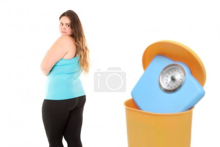 Large girl with  weight scale