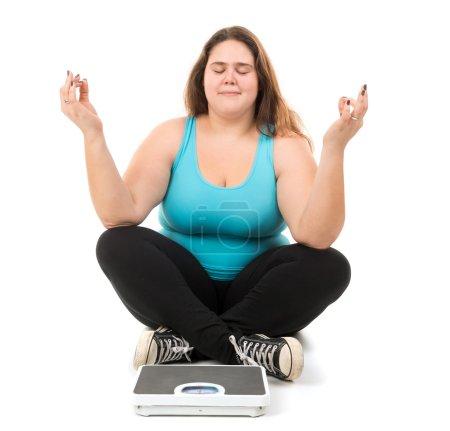 large girl doing yoga