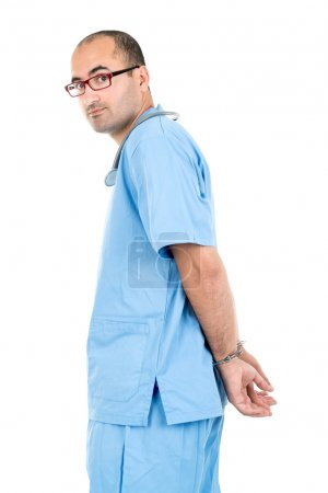 Photo for Male doctor in handcuffs isolated in a white backgroud - Royalty Free Image