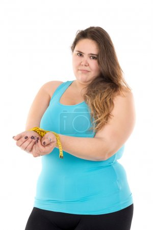 Fat woman with measuring tape