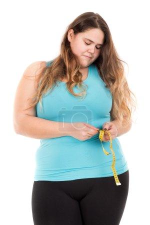 fat girl measuring waist