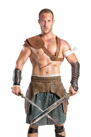 Photo for Gladiator warrior man posing isolated in a white background - Royalty Free Image