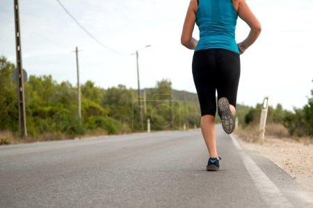Legs of running girl