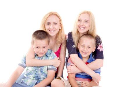 siblings posing together